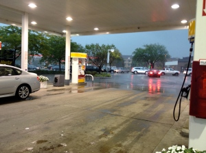 Standing at the gas station waiting for rain to stop